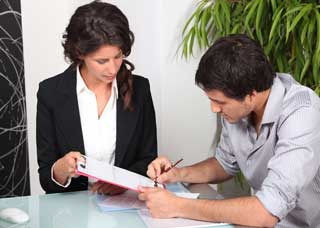 Woman having a man sign a contract